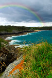 Atlantic coast in Brittany. Landscape of rocky Atlantic coast in Brittany France with stormy sky and rainbow Royalty Free Stock Photos