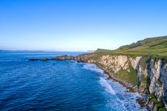 Atlantic coast in Northern Ireland with cliffs at Carrick-a-Rede stock images