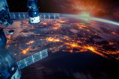 Atlantic coast of the United States night lights. And sunrise with lens flare from the space station. Earth with eclipse on starry sky. Elements of this image royalty free stock images