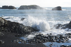 Atlantic coast, waves breaking on the volcanic basalt rocks, Dyrholaey view point, Iceland Royalty Free Stock Photography