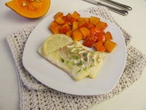 Atlantic cod fillet and red kuri squash Stock Photo