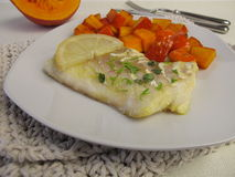 Atlantic cod fillet and red kuri squash Royalty Free Stock Photography