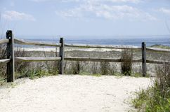 Atlantic Dune. A dune path with sun bleached fence to the beach of the Atlantic Ocean on a summer day Stock Images