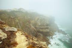 Foggy landscape in the area of Praia das Azenhas do Mar. Sintra, Portugal. The Atlantic mountain coast in the place between Praia das Macas and das Azenhas do royalty free stock image