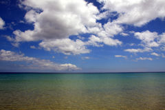 Atlantic ocean and blue cloudy sky Royalty Free Stock Image