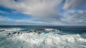 Atlantic ocean in Calhau das Achadas, Madeira. Atlantic ocean seascape. Waves comes to rocky shores with white foam and splashes. Calhau das Achadas, west coast Royalty Free Stock Photo