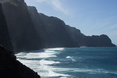 Atlantic ocean cliffs. Sea cliff drop to the atlantic ocean in Cape Verde. Waves and sunlight Royalty Free Stock Photos