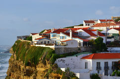 Atlantic Ocean coast, Azenhas do Mar village, Sintra, Lisbon, Po. Atlantic Ocean coast and Azenhas do Mar white village landmark on the cliff, in the stock photo