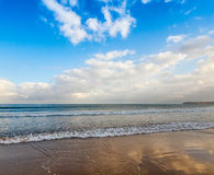 Atlantic ocean coast with bright cloudy sky Royalty Free Stock Image