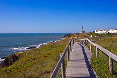 Atlantic ocean coast. Lighthouse on the shore of the ocean Stock Image
