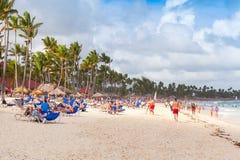 Atlantic ocean coast, many tourists resting on beach Royalty Free Stock Photos