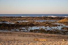 Atlantic Ocean coast in Portugal, Europe. Morning beach with rocks. Beach at sunset. Seascape at dawn. Summer evening coastline. Scenic panorama seashore royalty free stock photo