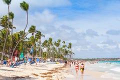 Atlantic ocean coast, tourists rest on a sandy beach Stock Image