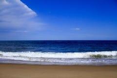 Atlantic Ocean coast. Walking along ocean beach in spring royalty free stock photos