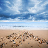 Atlantic ocean coast with wet small stones Stock Photos