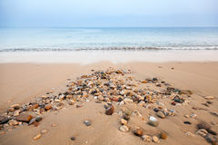 Atlantic ocean coast with wet stones Royalty Free Stock Photo