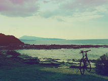 Atlantic Ocean Coastline with Bike at Sunset Stock Photography