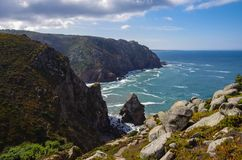 Atlantic ocean coastline view from Cabo da Roca Cape Roca is a cape which forms the westernmost extent of mainland Portugal. And continental Europe. Portugal stock images
