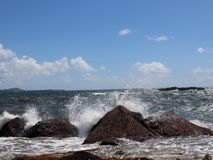 Atlantic Ocean crashes into rocks. Turbulent water of the Atlantic Ocean crashes into rocks boarding Vieques Island Puerto Rico stock image