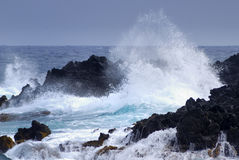 Atlantic Ocean crashing on the volcanic coast of Lanzarote Stock Photo