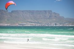 Kitesurfing in Atlantic ocean Capetown. Atlantic ocean kitesurfing in South Africa, Capetown Stock Images