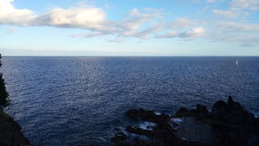 Atlantic Ocean and a little sailboat at Madeira island, Portugal Stock Photography