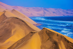 The Atlantic Ocean,  moving sand dunes, Namibia Royalty Free Stock Images