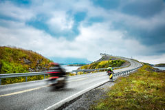 Atlantic Ocean Road Two bikers on motorcycles. Royalty Free Stock Images