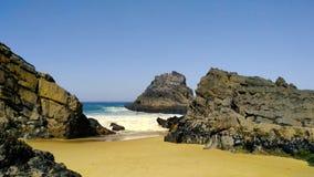 Atlantic ocean rocky coastline of Adraga beach. Portugal`s rocky coast. Rocky Atlantic ocean coastline of Adraga beach, Portugal rocky coast stock footage