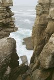 Atlantic ocean sprays water on rocks at Cruz do Remedios, near Peniche, west coast of Portugal Stock Image