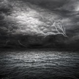 Atlantic Ocean Storm. Setting in. Lightning over storm clouds above the sea Stock Photo
