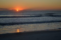 Atlantic Ocean Sunrise Morning - Sun Just came Up. The sun is coming up on a beach in Florida Stock Image