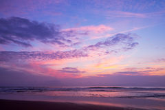 Atlantic ocean sunset with pink and purple sky Stock Images