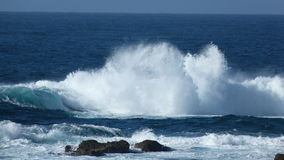 Atlantic Ocean Surf on a beach in Cornwall UK. Atlantic Ocean waves break onto a beach in Cornwall UK Stock Image