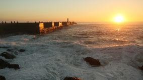 Atlantic ocean surf on the pier during a stunning sunset. Nature. stock footage