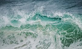 Green wave crushing Stock Photos