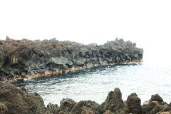 The Atlantic ocean waves hit the rocky shores of the Flores Island. Atlantic Ocean Coast on Flores Island, Azores, Portugal Stock Images
