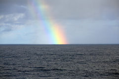 Atlantic rainbow. A rainbow over the atlantic royalty free stock photo