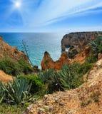 Atlantic rocky sunshiny coastline Algarve, Portugal. Atlantic ocean summer rocky coastline sunshiny view Ponta da Piedade, Lagos, Algarve, Portugal. Two shots Stock Photo