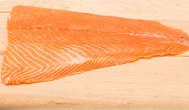 Atlantic Salmon on Cutting Board Royalty Free Stock Images