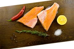 Raw trout on a wooden board. Atlantic Salmon with lemon on a wooden board. Top view Stock Photos