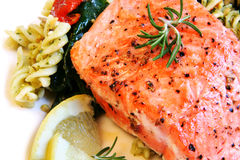 Atlantic Salmon and Pasta Salad. Grilled atlantic salmon fillet, with a fresh pasta salad. Garnished with rosemary, cracked pepper and lemon stock photography