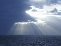 Atlantic Sunburst. The Sun's Rays burst from a storm in Mid Atlantic Ocean Royalty Free Stock Photography