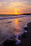 Atlantic sunrise. With wave on the beach Stock Photo