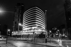 The Atlantic Tower Hotel by night black and white photography. ENGLAND, LIVERPOOL - 15 NOV 2015: The Atlantic Tower Hotel by night black and white photography Royalty Free Stock Images