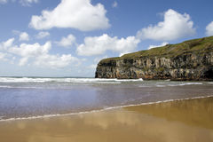 Atlantic waves on Ballybunion beach and cliffs Stock Photos