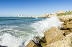 Atlantic waves crushing the waterbreaks in Cadiz, Andalusia, Spa. Atlantic waves breaking on the urbanized shore of old Cadiz, Andalusia, Spain Royalty Free Stock Photo