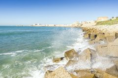 Atlantic waves crushing the waterbreaks in Cadiz, Andalusia, Spa. Atlantic waves breaking on the urbanized shore of old Cadiz, Andalusia, Spain Stock Photography