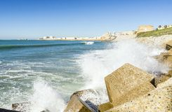 Atlantic waves crushing the waterbreaks in Cadiz, Andalusia, Spa. Atlantic waves breaking on the urbanized shore of old Cadiz, Andalusia, Spain Stock Photo