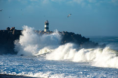 Atlantic waves and Light house Stock Images